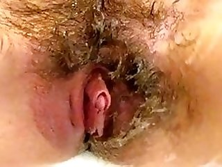 Shaving off my extreme hairy big clit pussy lips in close up