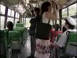 She strokes him and he fingers her on the bus