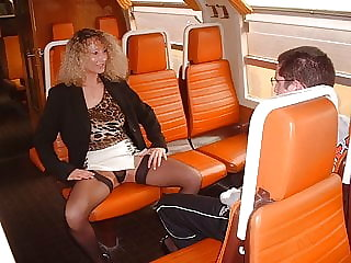 Amateur mom with boy in train