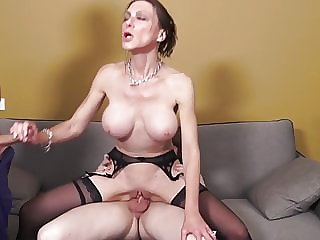 Mature MILF gets two cocks in all holes