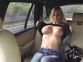 Busty blonde flashing in fake taxi before sex