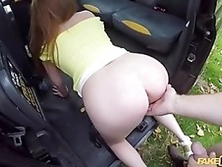 Redhead beauty with big boobs gets fucked in fake taxi