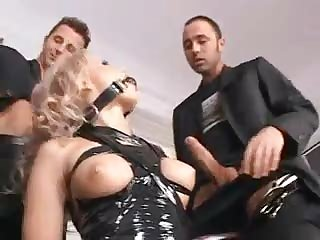 Blonde in collar and latex does gangbang