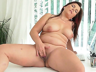 Euro milf Ria Black takes a well-deserved masturbation ...