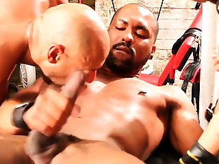 Muscular black jock serviced by gays in trio