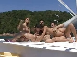 Two couples on a boat have erotic sex