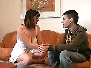 Horny MILF seduced a young boy.