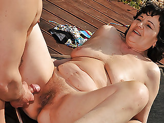 Chubby Granny massaged and fucked near the pool