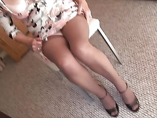 Busty mature granny in crotchless panties shows hairy pussy